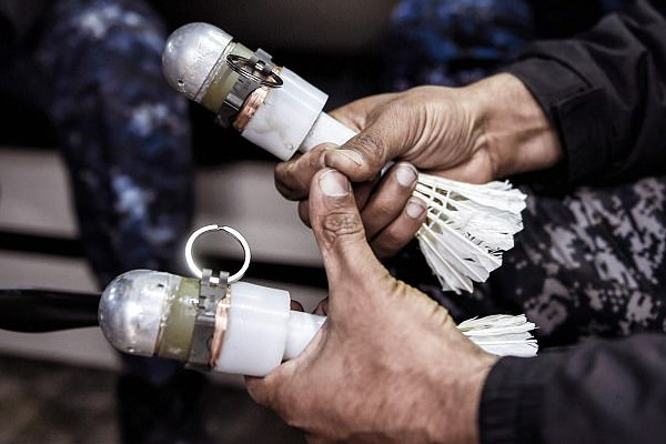 Two shuttlecock grenades were later retrieved in the dead man's body. Shuttlecock grenades are heavily used by ISIS forces but it's the first time someone tries to smuggle them inside their body, admit officials.