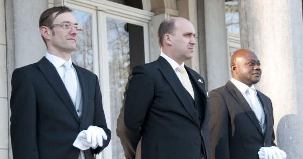 Former Royal Family butler, Edward H. Burrough III, (seen here in middle) believes his latest interview with the Hollywood enquirer, where he lifted the lid on Prince George's alleged homosexuality, has cost him his job and might cost him his own life.